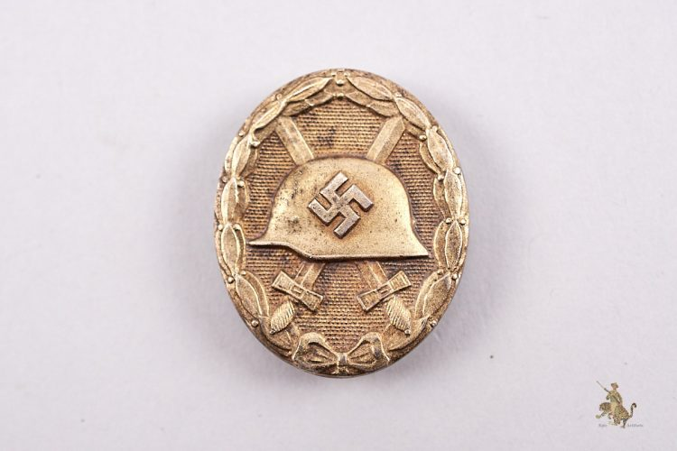 Gold Wound Badge marked 100